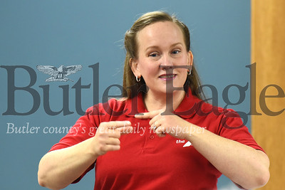Elizabeth Tillotson from Rose E. Schneider Family YMCA demonstrates American Sign Language signs for a workshop at the Zelienople Library Monday night. Seb Foltz/Butler Eagle 01/13/19