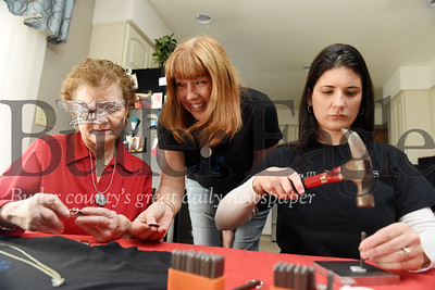 Harold Aughton/Butler Eagle: Linda Savanna of Butler, left, examines a piece of homemade jewelry with Toni Brooks of Sarver, while Linda's daughter Rachelle Savannah Haberberger works on another piece of jewelry.