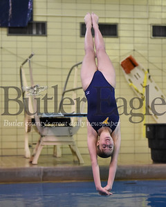 Butler's Paige Williams (first jump back dive) against North Allegheny. Seb Foltz/Butler Eagle
