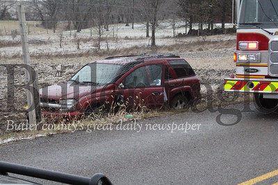 A portion of Slippery Rock Road in Slippery Rock Township is closed after a maroon SUV ran off the road Thursday afternoon. The accident is under investigation and the cause of the accident or whether injuries were sustained are unknown at this time.,Photo by Eric Jankiewicz/Butler Eagle