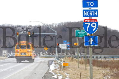 EDITORS NOTE: FOR FIRST RESPONDER STORY A school bus passes the I-79 onramp intersection on Little Creek Road, near Seneca Valley High School Tuesday. Seb Foltz/Butler Eagle
