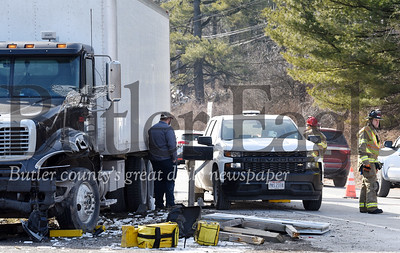 Harold Aughton/Butler Eagle: According to Pennsylvania State Police, a three-vehicle wreck occurred in front of Western Pennsylvania Windows on Evans City road when a box truck collided with a white work truck and a blue Honda Civic. According to PSP, one person was transported to a local hospital with head injuries.