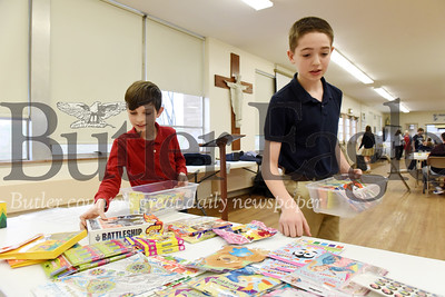 Harold Aughton/Butler Eagle: Daniel Hartle, left, and George Gabriel, sixth graders at Holy Sepulcher Holy Sepulcher recently filled containers as part of a Catholic school week service project.