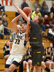 Harold Aughton/Butler Eagle: Knoch's Jake Schiedt, #33, draws a foul from Deer Lakes Ryan Butler, #42 in the first quarter.