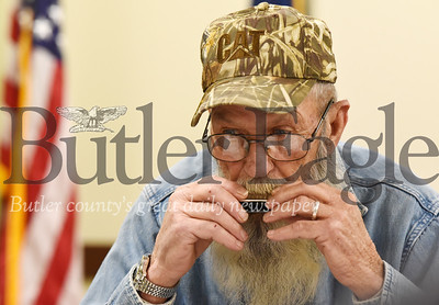 Harold Aughton/Butler Eagle: Harold Burns, a Vietnam Veteran who served in the Army, learns to play the harmonica during a new program to veterans combat the symptoms of COPD.