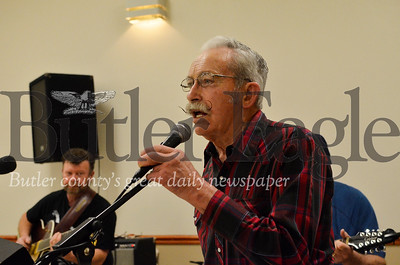 Bob Minor, a veteran square dance caller, hollers dance instructions to the crowd at the Harrisville Volunteer Fire Company's January square dance. Tanner Cole/Butler Eagle