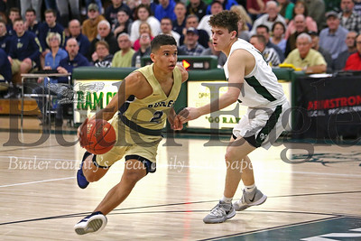 Butler's Devin Carney drives to the lane against Pine Richland's Jackson Sevco Tuesday in the Golden Tornado's section clinching win at Pine Richland. Seb Foltz/Butler Eagle