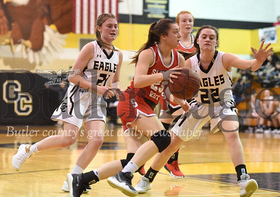 Slippery Rock's Anna Kadlubek breaks past Grove City's #21 Becca Santom and #22 Emma Santom during the basketball game at Grove City High School on Thursday, January 30, 2020. (Photo By: Erica Dietz)