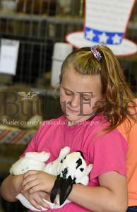 Harold Aughton/Butler Eagle: Emmaline Blatt, 9, of Butler snuggles with Layla, an English Spot rabbit, at the Butler Fair, Saturday, June 29.