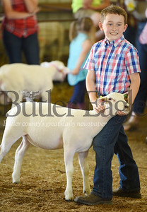 """Harold Aughton/Butler Eagle: Jack Meiser,8, of Butler and his sheep, """"Sweet Caroline"""" took third place in the showmanship competition, Monday, July 1."""