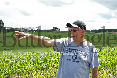 Ed Thiele points out another damaged section of his corn crop on a field toward the rear of his farm. Seb Foltz/Butler Eagle