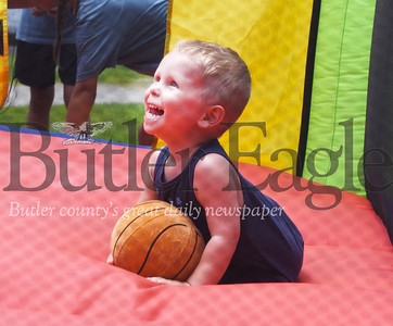 Harold Aughton/Butler Eagle: Lukarius Gould, 2, had a ball in the bouncy house at the carnival held at Rotary Park, Friday, June 28.