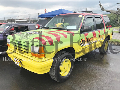 Marc Koszak of Allison Park owns a 1991 Ford Explorer he painted to resemble the vehicle in the original Jurassic Park movie. The vehicle was on display at the 19th annual Mega Cruise hosted by Penn Township Volunteer Fire Department. Photo by Gabriella Canales.