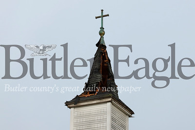 Firefighters on scene confirmed the steeple of St. Fidelis Parish on Penn Avenue in Lyndora was  struck by lightning Saturday afternoon. The strike tore through the roof of the steeple leaving shingles scattered around the church. No evidence of fire was visible from the street. Firefighters were inspecting the building shortly after the strike. Seb Foltz/Butler Eagle