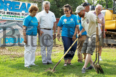 Barbara Gutzwiller,  Les Gutzwiller and Linda Gass watch as Aaron Kniess breaks ground at the future site of the Zelienople Skate Park. Seb Foltz/Butler Eagle