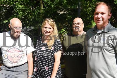 Harold Aughton/Butler Eagle: (Left to right) Zelienople neighbors Herb Weiner, Lynn ???, Robert Pegg, and Daniel Karns