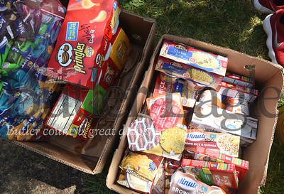 Harold Aughton/Butler Eagle: The Golden Tornado Scholastic Foundation collected food for the Kid's Weekend Backpack program Tuesday, July 9 at the Emily Brittain School.