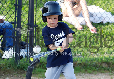 A.J. Dugan keeps his eye on the ball with a big swing for a hit that turned into a single Tuesday in 4-6-year-old Centertownship Little League action Tuesday. Seb Foltz/Butler Eagle