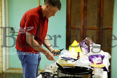 Andrew Skero scoops up some chili at the Orchard Hill Church of Butler's first annual chili cook off Wednesday at Trinity Presbytarian Church. Seb Foltz/Butler Eagle