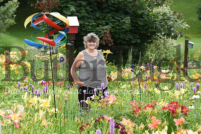 Harold Aughton/Butler Eagle: Karen Hall of Concord Twp. has planted more than 400 daylilies over the past 20 years.