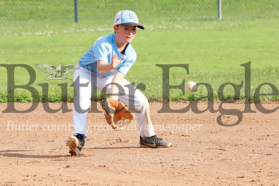 Seneca U10 all star tournament team shortstop Josh Marquardt fields a throw to try to catch a runner at second base during tournament play against Shaler Thursday evening in Zelienople. Seb Foltz/Butler Eagle