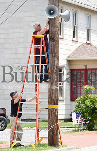 Harold Aughton/Butler Eagle: Saxonburg firefighters and paramedics, Paul Donaldson (holding ladder), and Chuck Lewis troubleshoot just in time for tonight's Saxonburg Fireman's Parade.