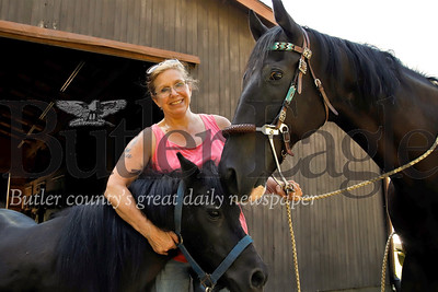 Kim Dugan of Evans City and her horses. GED Community story. Seb Foltz/Butler Eagle