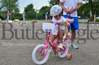 Aria O'Brien, 5, rides her bicycle through the course at the fifth annual Cranberry Township Bike Rodeo at Community Park
