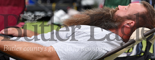 Harold Aughton/Butler Eagle: Christian Werner of Butler takes a quick nap prior to his Relay for Life walk at the Butler Farm Show grounds, Saturday.