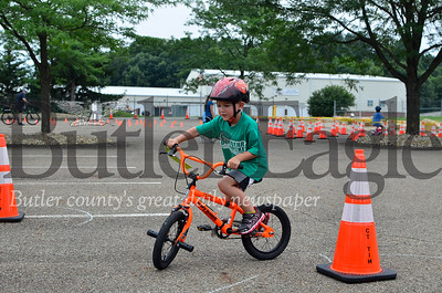 Lincoln Maffei, 5, of Wexford rides his bicycle through the course at the fifth annual Cranberry Township Bike Rodeo at Community Park.