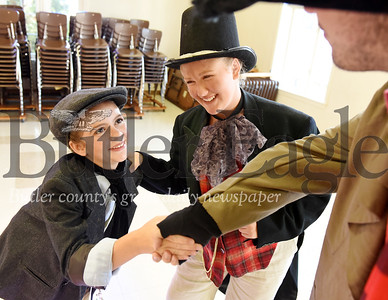 Harold Aughton/Butler Eagle: Sophia Cornetti, 11 of Butler greets Draven Stuart, who plays Fagin while fellow actor Reilly Martin, 12 who plays the part of the Artful Dodger looks on...