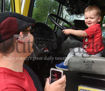 Harold Aughton/Butler Eagle: George Bellamy of Butler Twp., takes a photo of his son, Rudy, 2, during Evans City's Touch-a-Truck event.