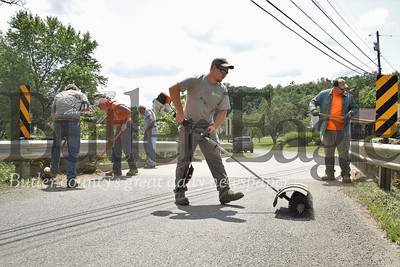 Hunter Bartolicius (center) and the Butler County bridge work crew inspect and maintain the Muddy Creek Drive bridge over Muddy Creek near Route 8, south of Slippery Rock. Seb Foltz/Butler Eagle 07/25/19