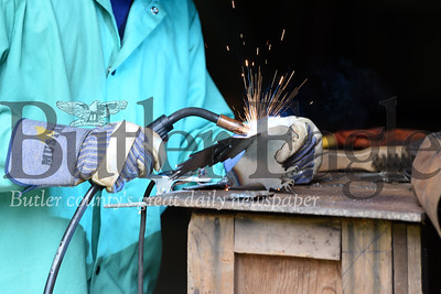 Harold Aughton/Butler Eagle: Life Scout Edward Ditch, 14, of New Castle welds the wing onto his Eagle at Campu Bucoco.