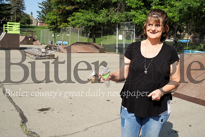 Father Marinaro Park story: Area resident and park volunteer organizer Cindy Parker picks up trash in the skate park. Parker is behind an effort to maintain and improve park facilities. Seb Foltz/Butler Eagle
