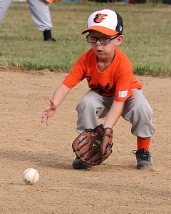 Quentin Gardner fields a ground ball in a 6-8-year-old Center Township little league game last week. Seb Foltz/Butler Eagle 06/26/20