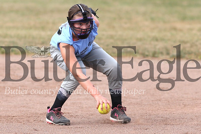 Brynn Britco picks up a gounder to make a play at first during a Seneca Valley vs. Mars 10-and-under game earlier this month. Seb Foltz/Butler Eagle (July 2020)