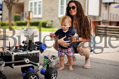 Jessica Kerr of Mars and her son Conor check out Rov-E, a NASA Mars Rover inspired remote control vehicle at this year's Mars celebration. Seb Foltz/Butler Eagle
