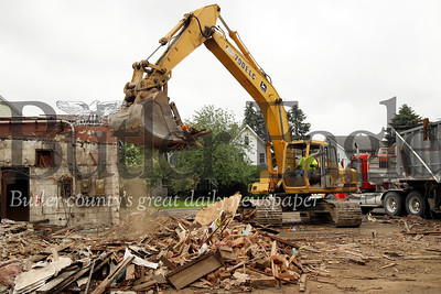 Jake Dressler of DemEx Demolition & Excavating clears debris of the old Serventi's restaurant on Chestnut St. in Butler. The property was purchased by a retirement community. Construction officials said the old restaurant site will become retirement housing. Seb Foltz/Butler Eagle