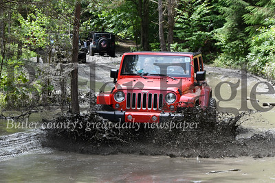 Harold Aughton/Butler Eagle: Several thousand jeep enthusiasts gathered at Cooper's Lake for the 9th Annual Bantam Jeep Festival, Saturday, June 8 to ride the trails and play jeep games.