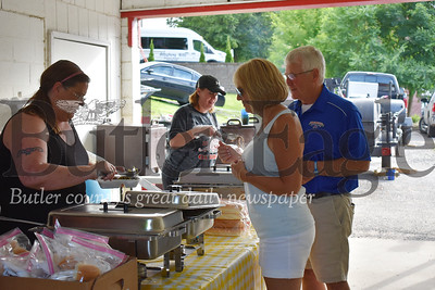 Terry and Debbie Henry get served dinner by volunteers Renee Patton and Melissa Malloy at the 2019 Ox Roast in East Brady on Saturday. Proceeds from the community dinner go to support the borough's upcoming 34th Annual East Brady Riverfest in July.