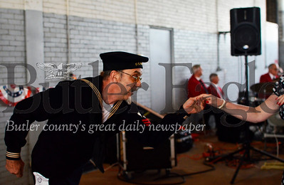 Don Vaughn, 58, dances in his uncle's U.S. Navy uniform in remembrance of fallen soldiers. Tanner Cole/Butler Eagle