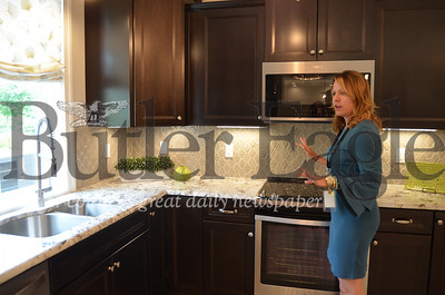 Megan Prazer, Weaver Homes design coordinator, showcases her favorite details in a kitchen model.
