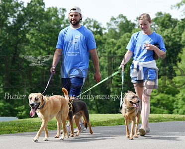 Harold Aughton/Butler Eagle: David Thinnes of Meridian and his fiancee, Kristen Cully walk their dogs, Macy, Xena and Mellie at the 2nd Annual Memorial Mutt Strut in memory of Garrett Field. Garrett was known for his love and commitment to animals of all species and was often referred to as the animal whisperer!