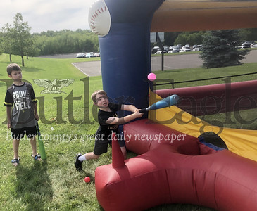 Photo by Michele JurystaBlake, 5, from Mars, hits a ball Saturday during Adams Township Community Day.