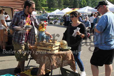 Area residents and vendors enjoy sunny skies for Monday's Ziellienople Farmers Market. Seb Foltz/Butler Eagle