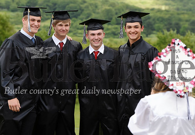Harold Aughton/Butler Eagle: Classmates (left - right) Jared Lominski, Tyler McFadden, Slade Hutchinson and Lee DeMatteis pose for a picture taken by Madison Cuberland at Moniteau's High School Graduation.