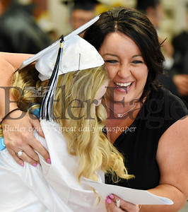 Harold Aughton/Butler Eagle: Senior advisor, teacher, Wendy Taylor congratulates senior Presli Hollefreund at Moniteau's High School Graduation.