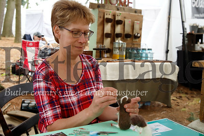 Linda Musko of Butler works on a new needle-felted wool animal while tending her booth at Whispering Pines Saturday. Seb Foltz/ Butler Eagle