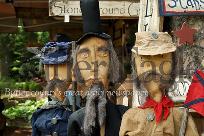 Abraham Lincoln and Civil War soldiers stand guard at the Sweet Pickins booth at Whispering Pines. Seb Foltz/ Butler Eagle